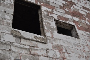 Detail from exterior. Notice how windows are no longer covered with boards. Photo taken yesterday.